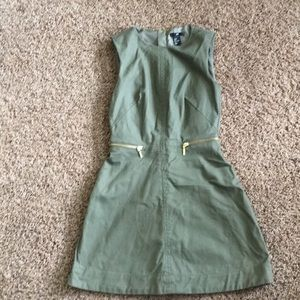 Army green sleeveless mini dress with gold zips